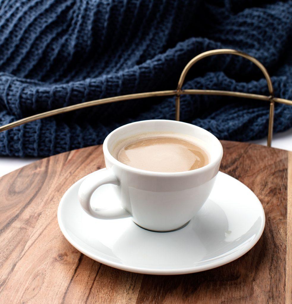 creamy coffee on a tray